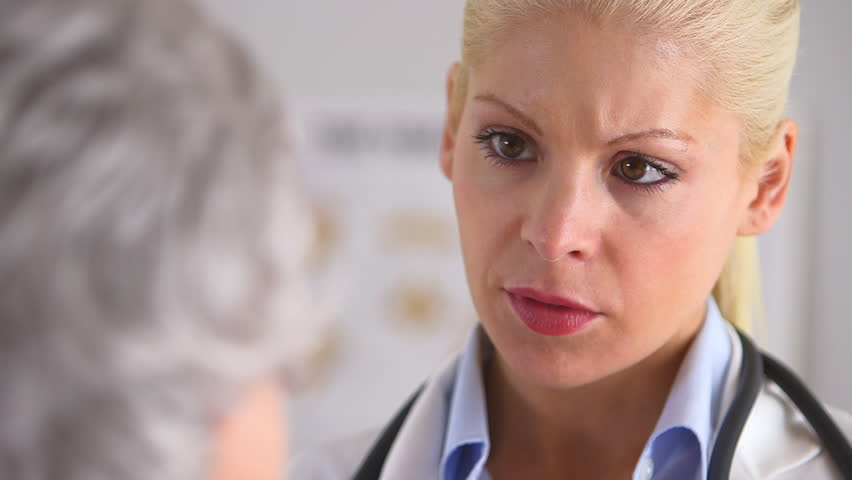 Close up of concerned doctor talking to patient   Shutterstock HD Video #4498385