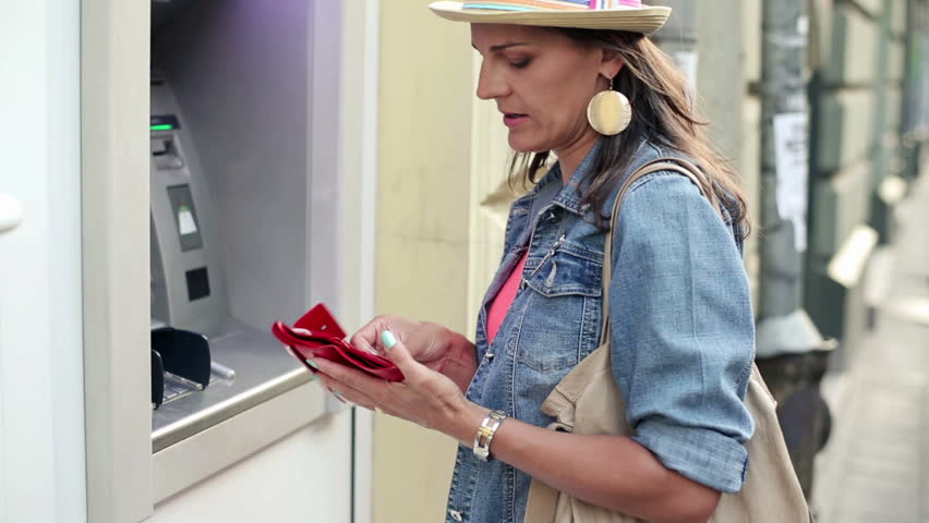 Woman taking cash from atm machine in the city  Royalty-Free Stock Footage #4499522