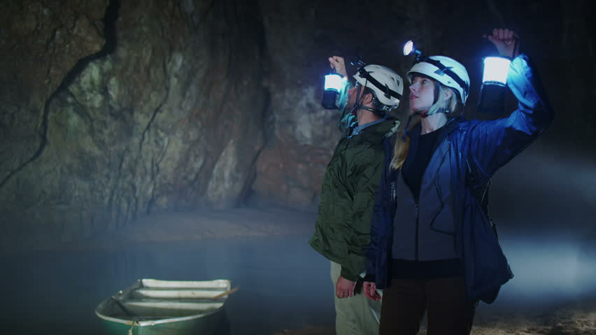 Scientists and miners exploring dark caves. Geologists, explorers, adventurers, pot holing, historians or mining company.   Shutterstock HD Video #4502234