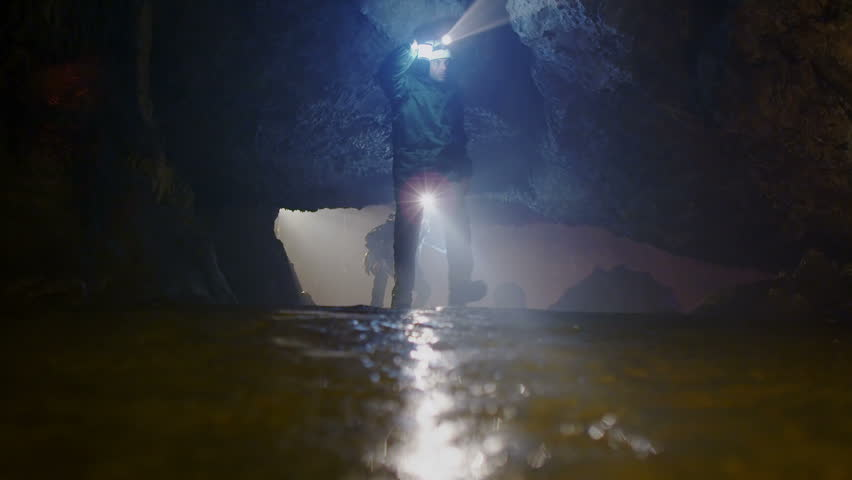 Scientists and miners exploring dark caves. Geologists, explorers, adventurers, pot holing, historians or mining company.   Shutterstock HD Video #4502237