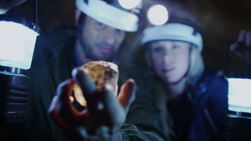 Caver discovers rare rock minerals or diamonds. Scientists and miners exploring dark caves. Geologists, explorers, adventurers, pot holing, historians or mining company.   Shutterstock HD Video #4502246