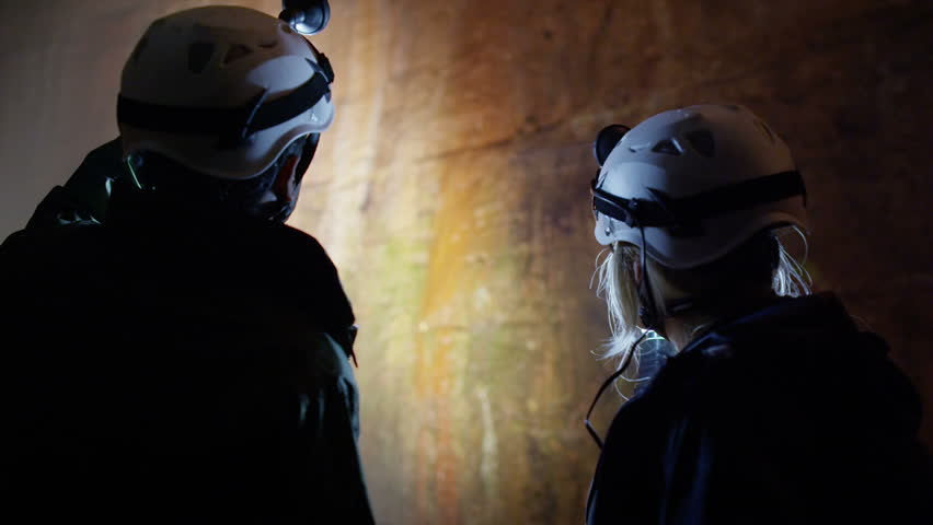 Scientists and miners exploring dark caves. Geologists, explorers, adventurers, pot holing, historians or mining company.   Shutterstock HD Video #4502249