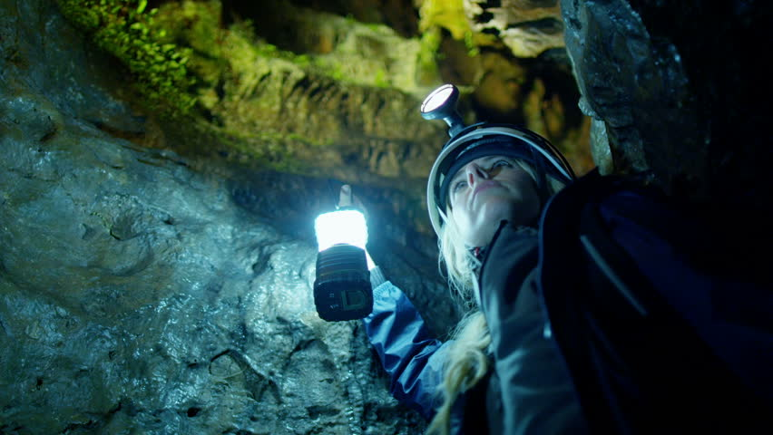 Scientists and miners exploring dark caves. Geologists, explorers, adventurers, pot holing, historians or mining company.   Shutterstock HD Video #4502252