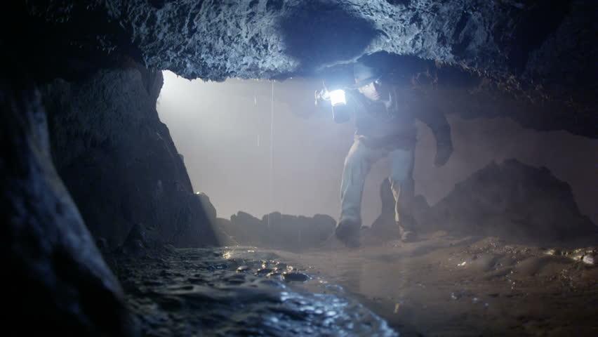 Explorer enters cave looking for treasure   Shutterstock HD Video #4502264