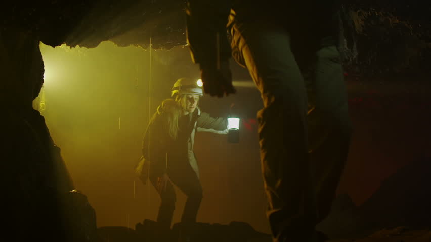 Scientists and miners exploring dark caves. Geologists, explorers, adventurers, pot holing, historians or mining company.   Shutterstock HD Video #4502345