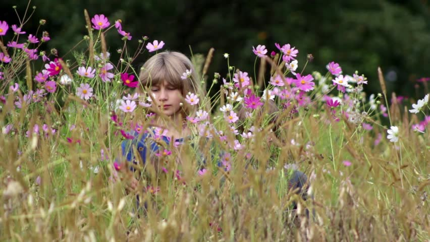 Children play with wildflowers | Shutterstock HD Video #4510415