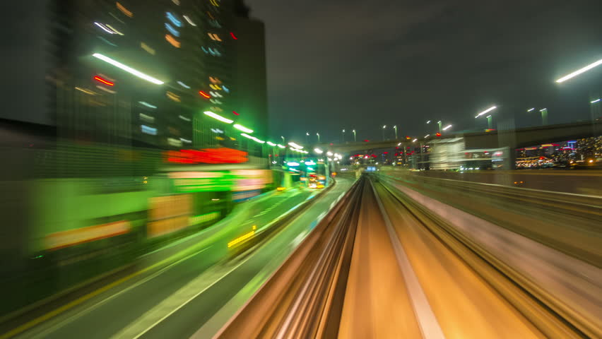 TOKYO, JAPAN - AUGUST 24: Time lapse from the Yurikamome on July 8, 2013, an automated guideway transit service operating along Tokyo Bay in Tokyo, Japan. | Shutterstock HD Video #4513337