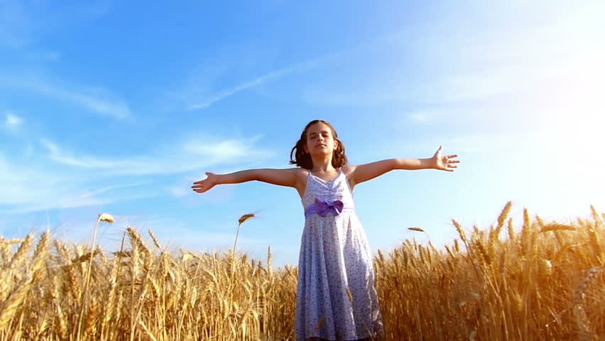 Little girl running cross the wheat field at sunset.Slow motion,high speed camera