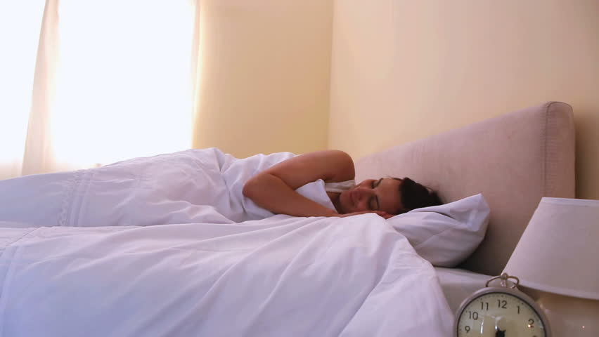 Woman waking up stretching and going to open curtains | Shutterstock HD Video #4528181