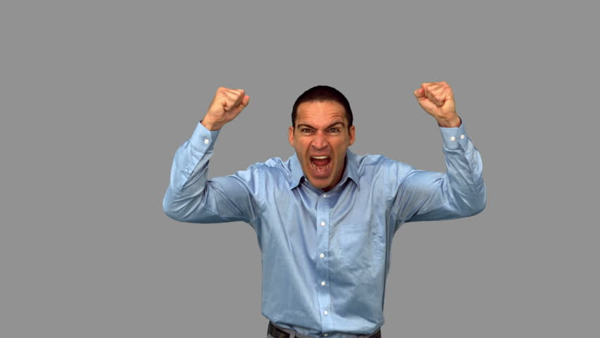 Angry businessman raising arms on grey screen in slow motion | Shutterstock HD Video #4530542
