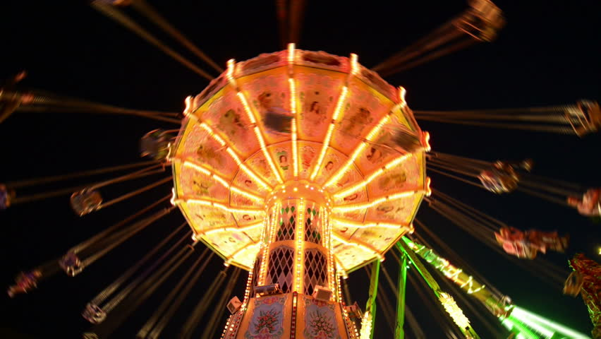 A classic carousel (super wide shot) on a funfair like Oktoberfest. All recognizable people or names/logos are blurred out by motion or hand.11059   Royalty-Free Stock Footage #4532771