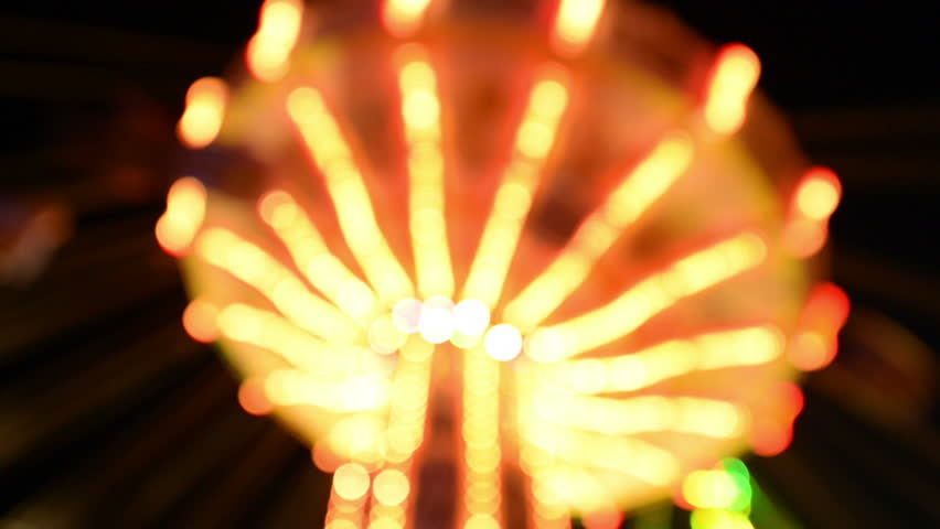 A classic carousel (chairoplane) on a funfair like Oktoberfest with nice out of focus lights..11062   Royalty-Free Stock Footage #4539959