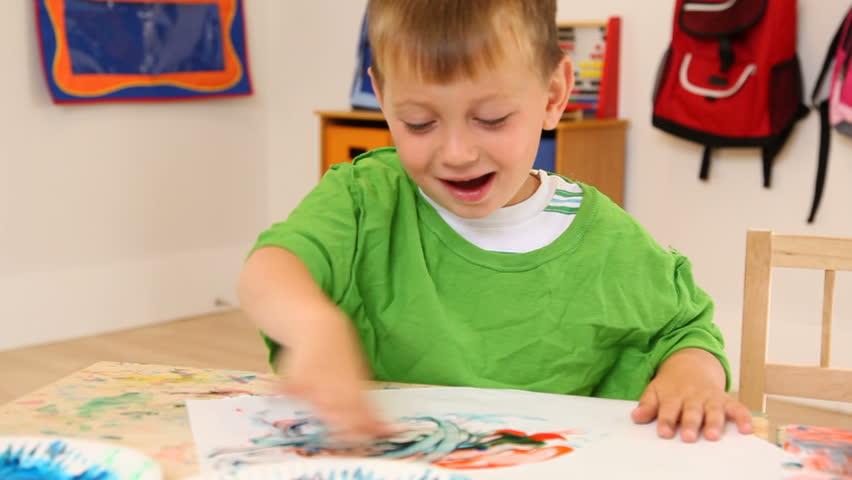 Preschool boy finger painting