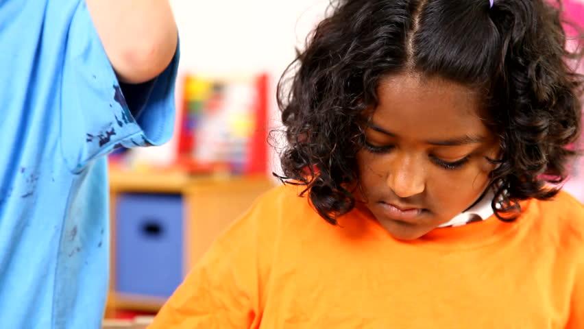Preschool kids with paint on hands