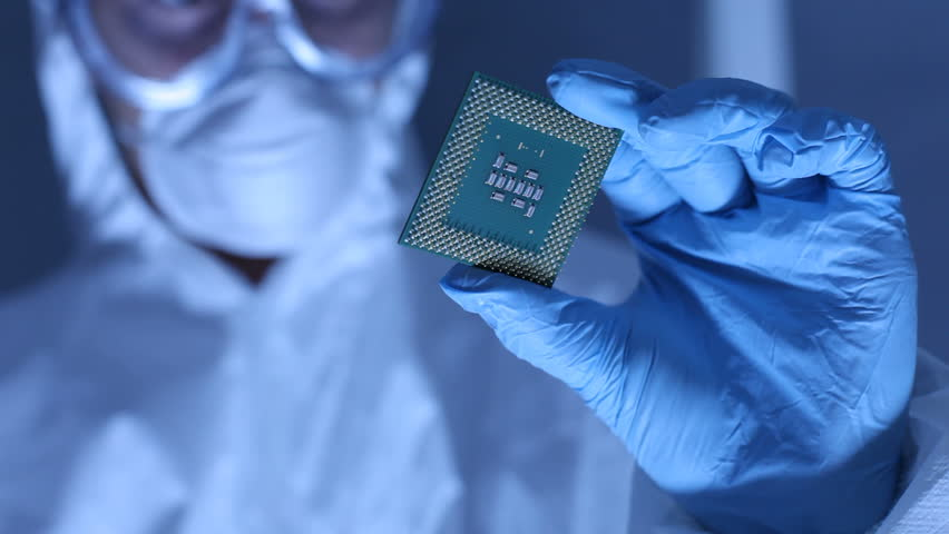 Man in clean room holds up computer cpu microchip Royalty-Free Stock Footage #4558385