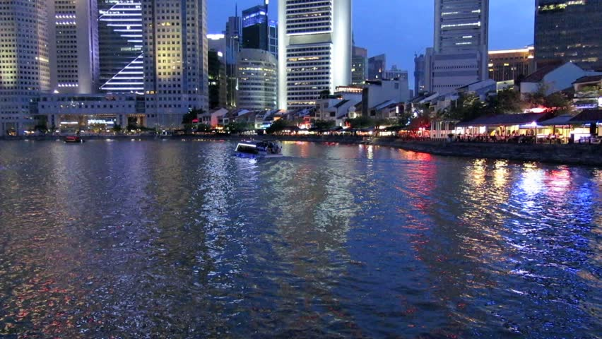Time lapse of river cruise boats on the Singapore River at dusk | Shutterstock HD Video #4560518