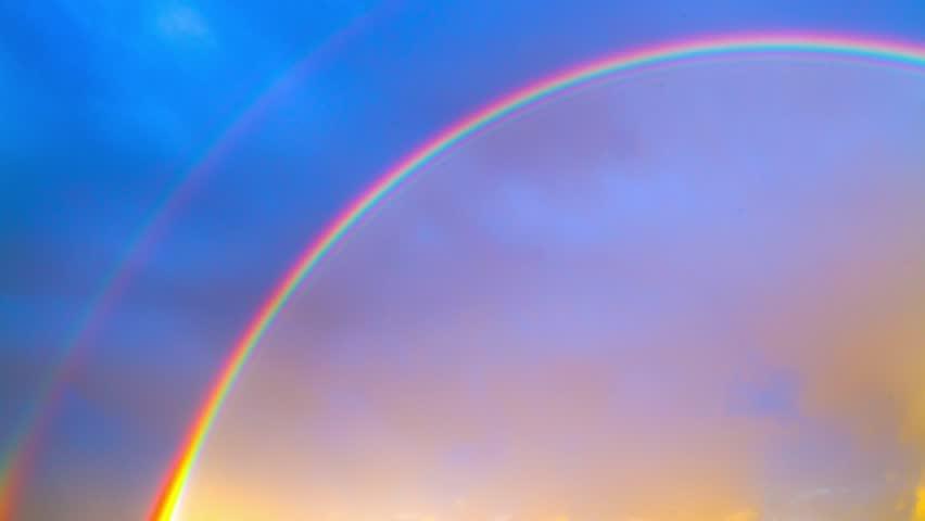 rainbow on blue sky, time-lapse