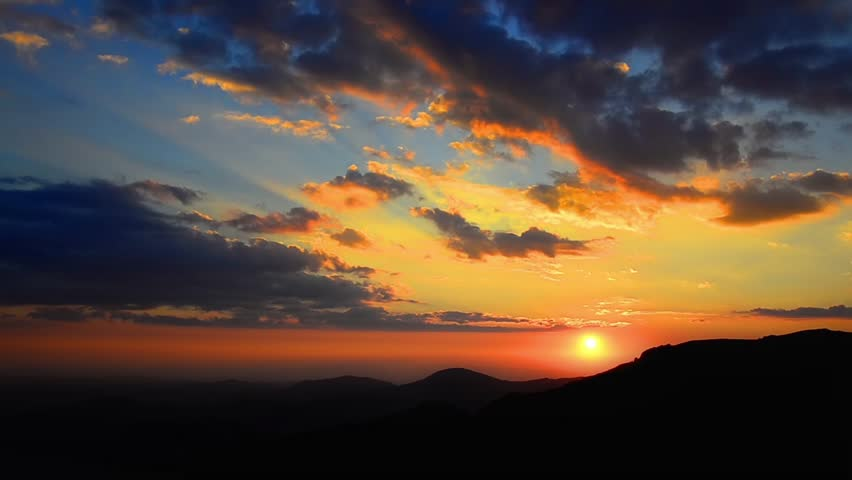 Amazing colorful timelapse sunset over Macedonia mountain chain. Time lapse sky background. Beautiful fiery sunset wide angle lens.