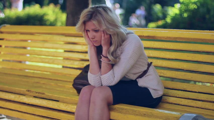 Head ache problem depression sad young business woman in park