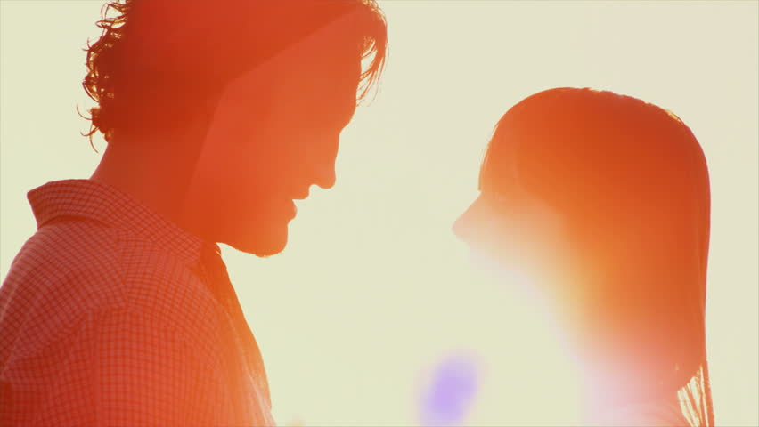 Beautiful Young Couple in Love kiss in the sun #4580033