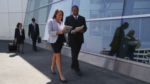 Business people at airport, working on the go