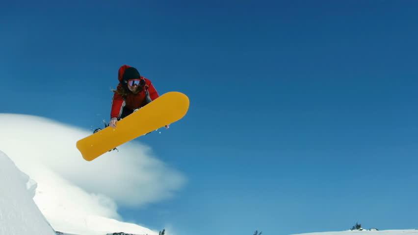 Snowboarder jumps into sky, slow motion | Shutterstock HD Video #4587374
