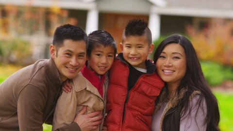 Closeup portrait of asian family in fall