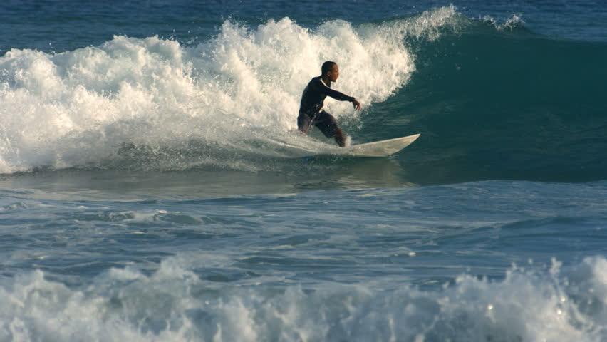 Surfer rides wave, slow motion #4595078
