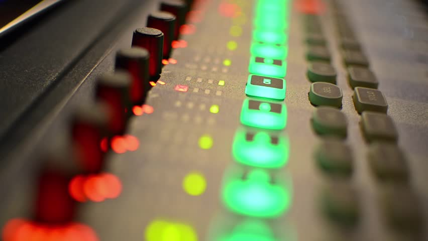 Music Mixer desk table in recording studio. highest quality. closeup footage with shallow depth of field