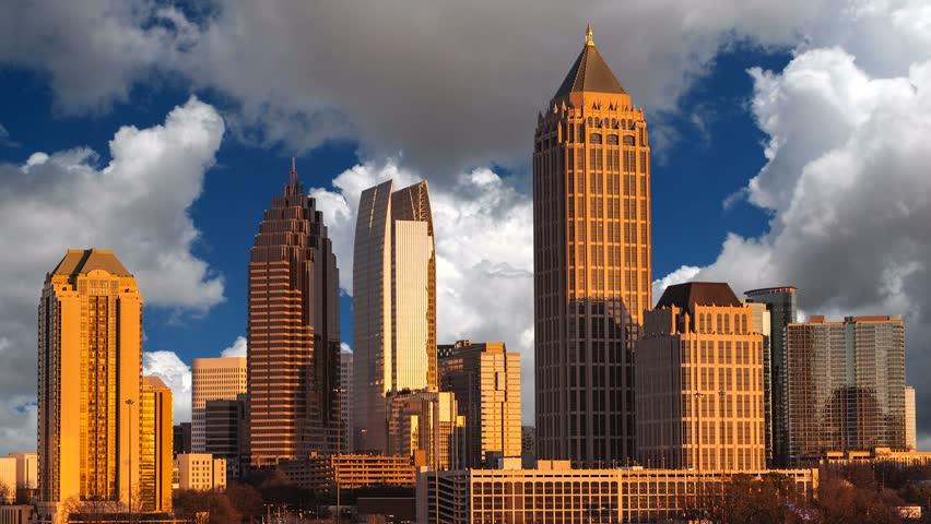 Atlanta Georgia midtown skyline with time lapse clouds.