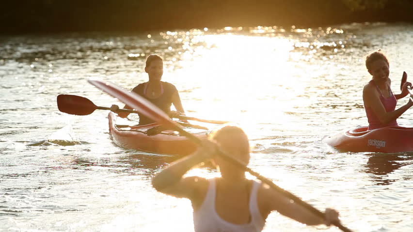 Young people canoeing in the lake | Shutterstock HD Video #4601408