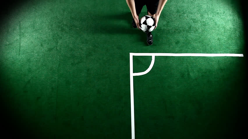 Soccer player prepares for a corner kick, then kicks the ball. Wide shot from above #4602845