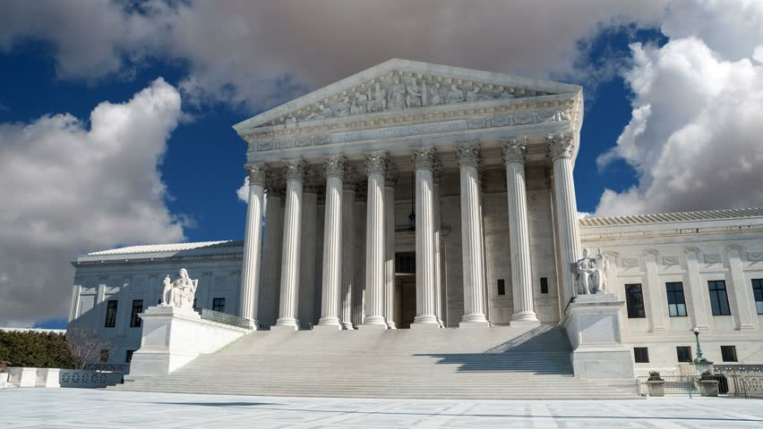 US Supreme Court with gathering storm clouds time lapse in Washington DC.