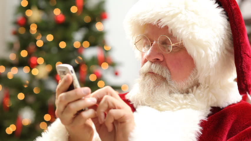 Santa Claus talking on cell phone | Shutterstock HD Video #4618766