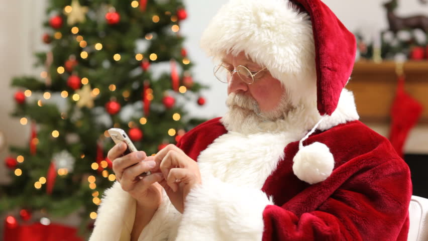 Santa Claus talking on cell phone at Christmas | Shutterstock HD Video #4618781