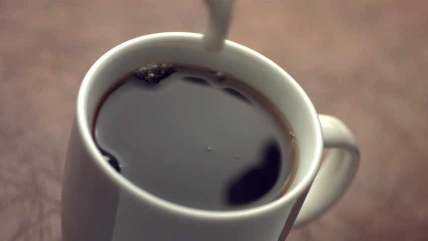Cream splashing into coffee cup, slow motion #4620485