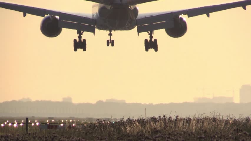 777 Airplane landing at sunrise