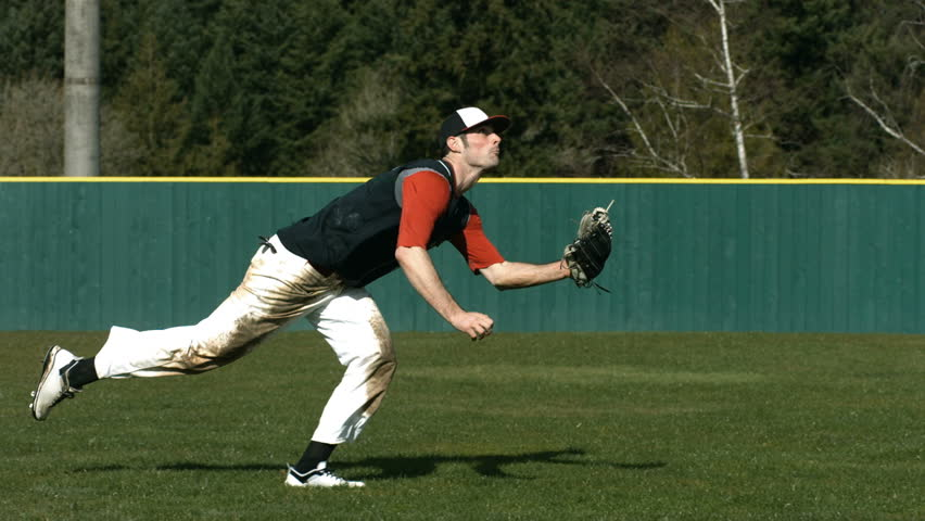 Baseball player catching ball, slow motion