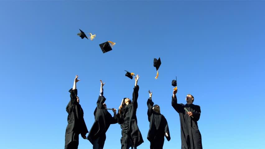 Graduates toss caps into sky