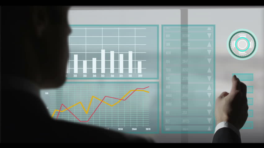 A businessman walks up to a window and touches it with his devise that brings up all his work data. Close up shot. | Shutterstock HD Video #4637135