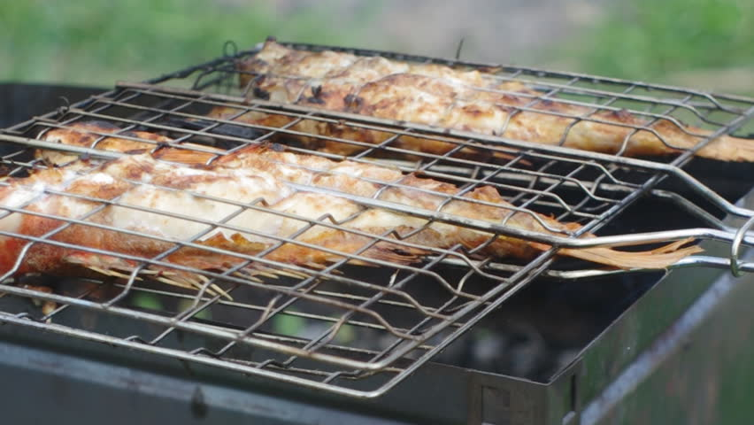 Rock Fish on the grill with flames . grilling sea fishes on campfire grate | Shutterstock HD Video #4638854