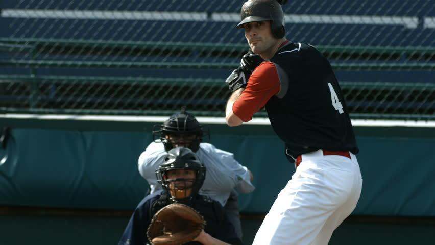Baseball player hitting ball, slow motion