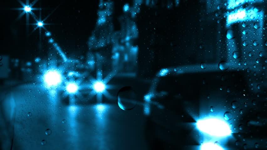 Night. City traffic. Outside the window the rain. Rain drops on the glass #4656050