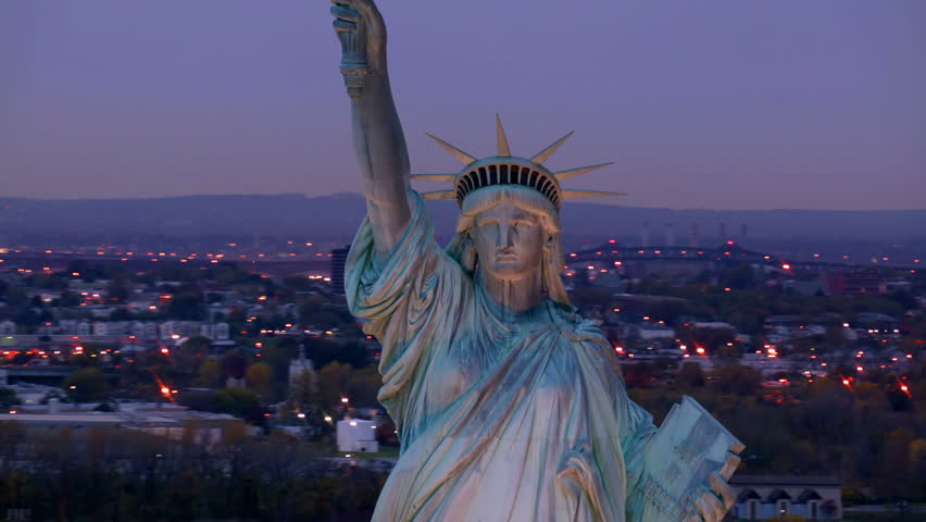 Statue of Liberty at dusk, aerial shot