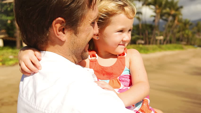Middle aged father holds daughter in his arms. | Shutterstock HD Video #4663373