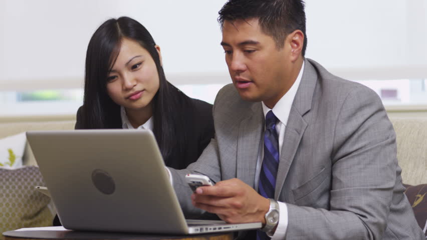 Business man and woman using laptop in office lobby | Shutterstock HD Video #4664954