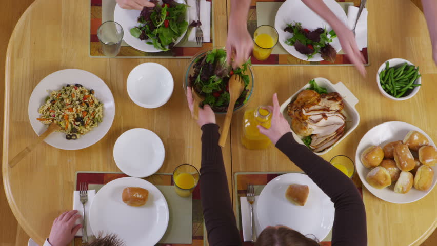 Family having dinner together, overhead view | Shutterstock HD Video #4665083