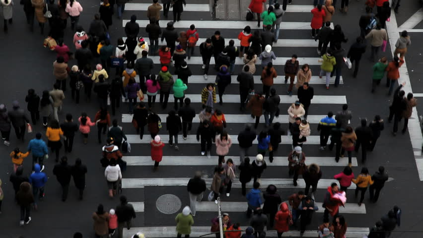 Time lapse of people and vehicles at pedestrian crossing intersection on busy road in central Shanghai, China