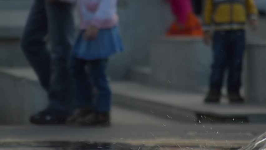 Fountain in Cluj Napoca Romania, dad walks his daughter in background | Shutterstock HD Video #4668812