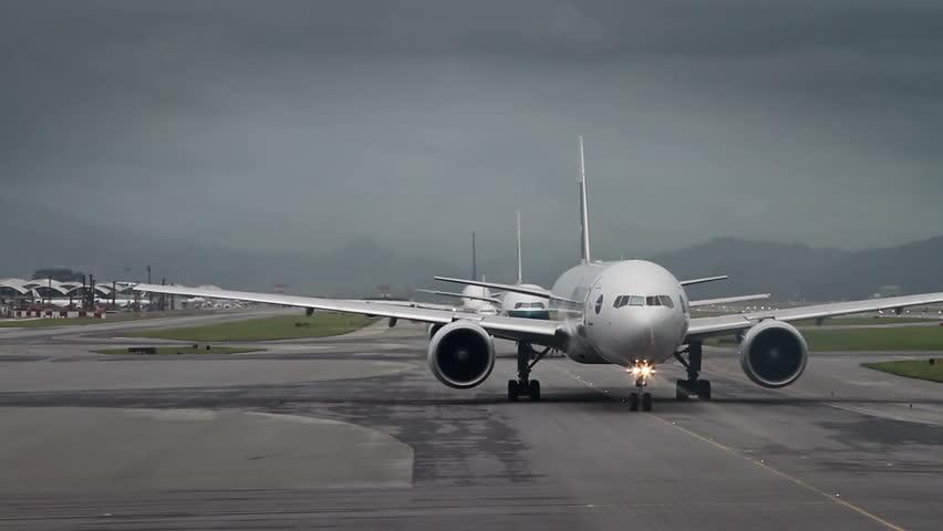 Airport traffic: waiting for takeoff permission aircrafts on runway, Hong Kong International Airport, Chek Lap Kok Airport.